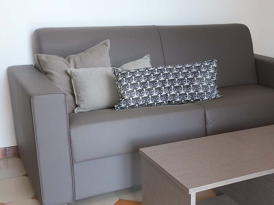 The couch in the living room of Casa Chiàppara